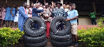 MP Kpodo (second left) presenting the tyres to the headmaster