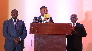 Chairman of the event, Nana Osei Bonsu (M) launching the report at the ISSER Conference hall