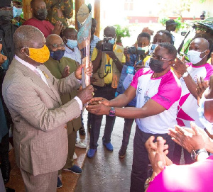 GOC President, Ben Nunoo Mensah passing on the baton to Otumfuo