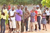 File: Voters in queue to vote
