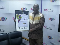 CEO of Citi FM displays the Do Ghana Good campaign plaque