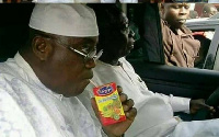 Nana Akufo-Addo, was spotted in his vehicle drinking Kalypo