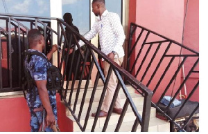 GTA officials closing down a hotel in Kumasi