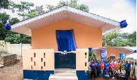 Newly constructed toilet at the Akropong School for the Deaf. inset: Some members of Stanbic Bank
