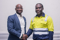 Clarence Nartey (left) in a handshake with Eric Asubonteng