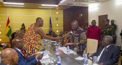 President Akufo-Addo receiving a document from Nana Otuo Siriboe II