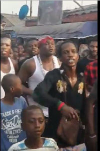 Bukom Banku with some people protesting against gayism