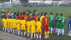 The Black Stars exchanging pleasantries with the Comoros team before kick-off