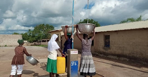 A file photo of people fetching water