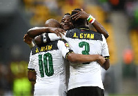 Wakaso embraces Ayew and Asamoah Gyan after they take the lead