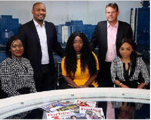 Peace Hyde seated in the middle
