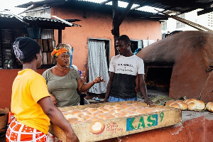 Maame Konadu interacting with her clients