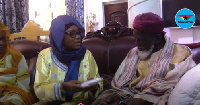 Gender Minister, Cynthia Morrison presenting an undisclosed amount of money to the Chief Imam