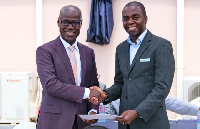 Dr Kojo Taylor (L) receiving a SafeCare certificate from Dr Maxwell Antwi