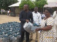 Deputy Minister of Power, John Jinapor distributing cylinders