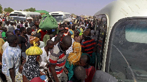 File photo: Migrants at a bus station