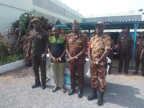 Officers of Yendi Prison in a photo with Crime Check Foundation representative