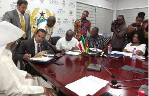 Finance Minister, Ken Ofori-Atta signing the deal with the delegates fro Kuwait