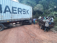 An articulated truck which has halt Human and vehicular activities