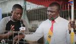 Roasted corn seller, Patrick Sosu with DJ Nyami