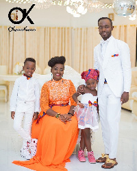 Okyeame Kwame with his wife and kids