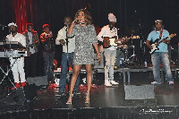 Mzbel on stage at concert in Belgium
