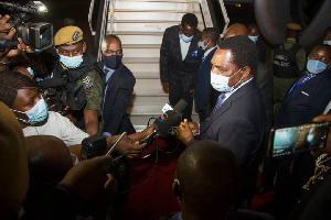 Hichelima addressing the press before boarding his flight for NY