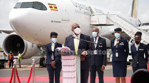 Uganda's Prime Minister Dr Ruhakana Rugunda (white mask) addresses guests