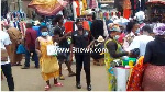 Police personnel enforcing mask wearing in the market