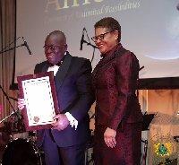 President Akufo-Addo being presented with a Congressional Record by US Congresswoman Karen Ruth Bass