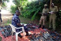 Police officers in Kyoga Region prepare firearms for fingerprinting, Photo/ Uganda Police Force