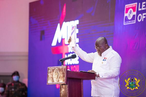 President  Nana Addo Dankwa Akufo-Addo holding a copy of the NPP's 2020 Manifesto