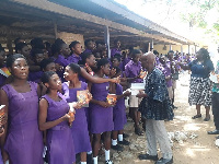 The students receiving the Bibles from the delegation