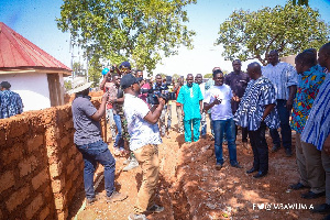 Dr Mahamudu Bawumia interacting with works at the third medical drone delivery service at Kukua