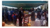 Rev Isaac Mensah, Senior Pastor, Fountain Gate Chapel presenting gifts to Teshie orphanage home