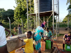 Residents of Canteen in Damongo fetching water from the community borehole