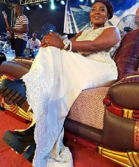 Florence Obinim was seen wearing the huge boots at her husbands ( Bishop Obinim) church