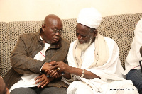 Akufo-Addo interacting with the Chief Imam