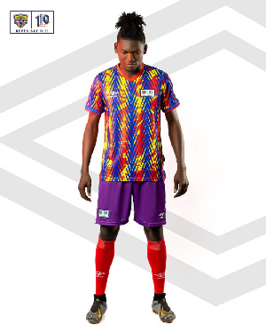A Hearts player models the new home jersey