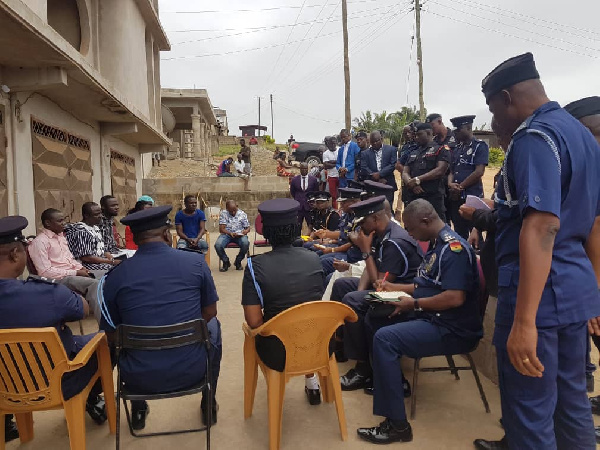 The Acting IGP and his team at one of the girls' house