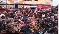Heaps of rubbish gathered in front of the market