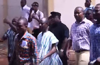 Koku Anyidoho clad in black with others walking to the CID headquarters when he was 'arrested'