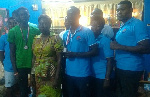Mrs Horsu Fianu , Eastern Regional Director, Sports Authority (middle)  flanked by the two medalists