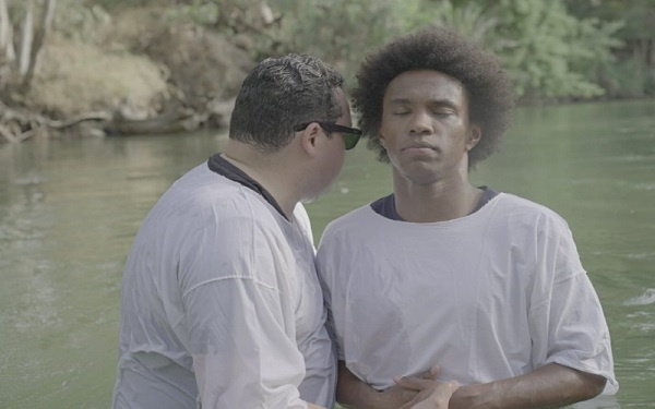 Willian getting baptized in the Jordan
