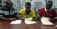 General Manager of Kotoko Opoku Nti, Gyamfi and his Manager during the signing