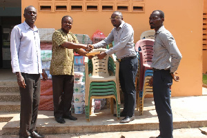 Yaw Asante receiving the items on behalf of the Assembly during the presentation