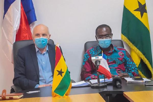 Dr Joseph Siaw Agyepong sitting next to Phillippe Hardouin