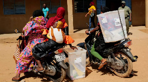 Burkina Faso Electoral Officers Trasnporting Ballot Boxes.png