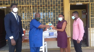 Mr. Kuranchie presenting samples of the two books to an official of the Osu Children's Home.
