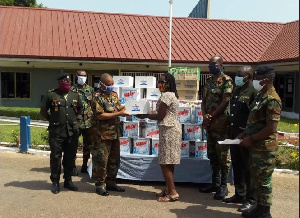 Brigadier General Nii Adjah Obodai, receiving the items from Patience Adzo Emeiabo on behalf o the